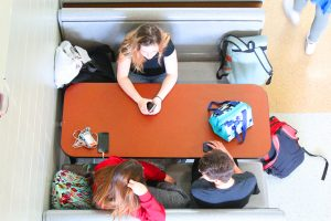 Students at table in lunchroom