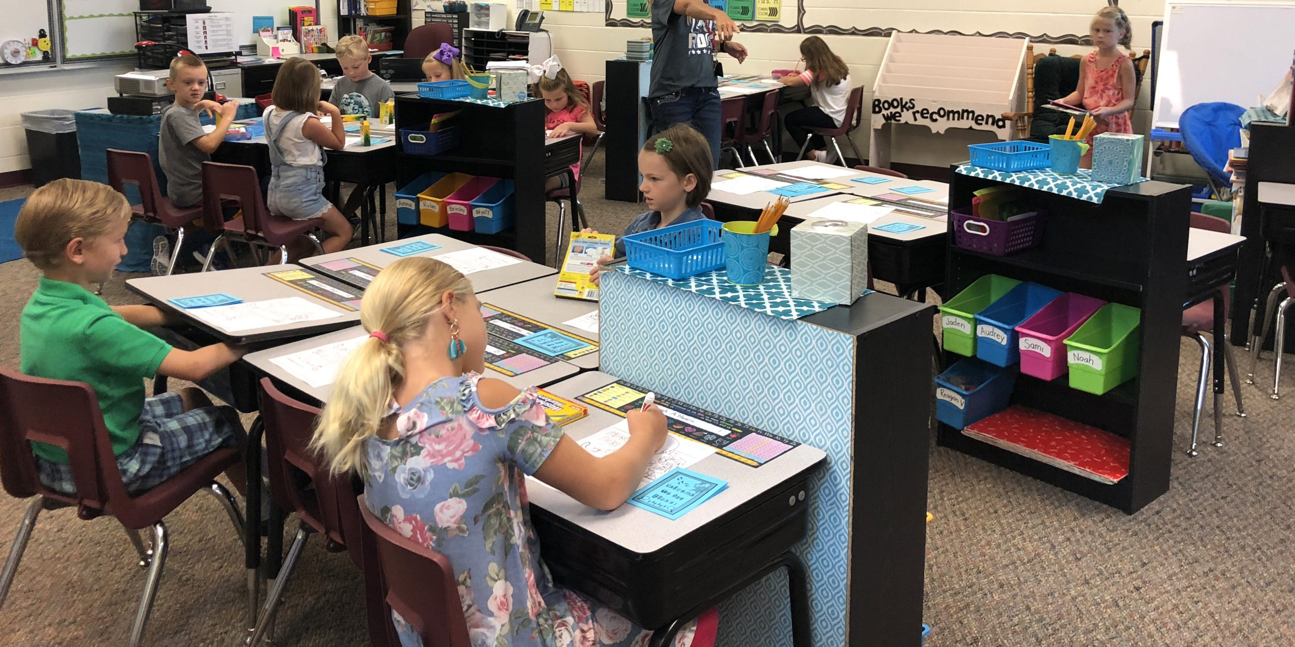 Elementary students working at their desks