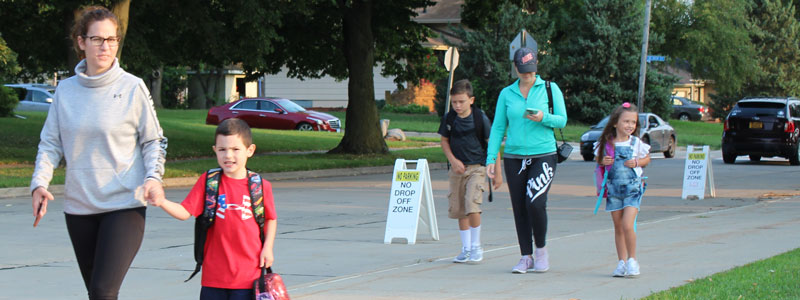 Parents walking children