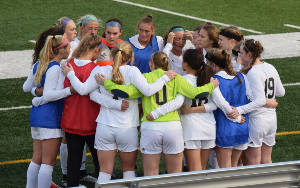 2019 soccer team huddles