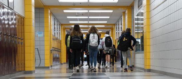 student walking in hallway